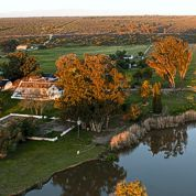 Photograph taken while Julian flew over the farmstead .